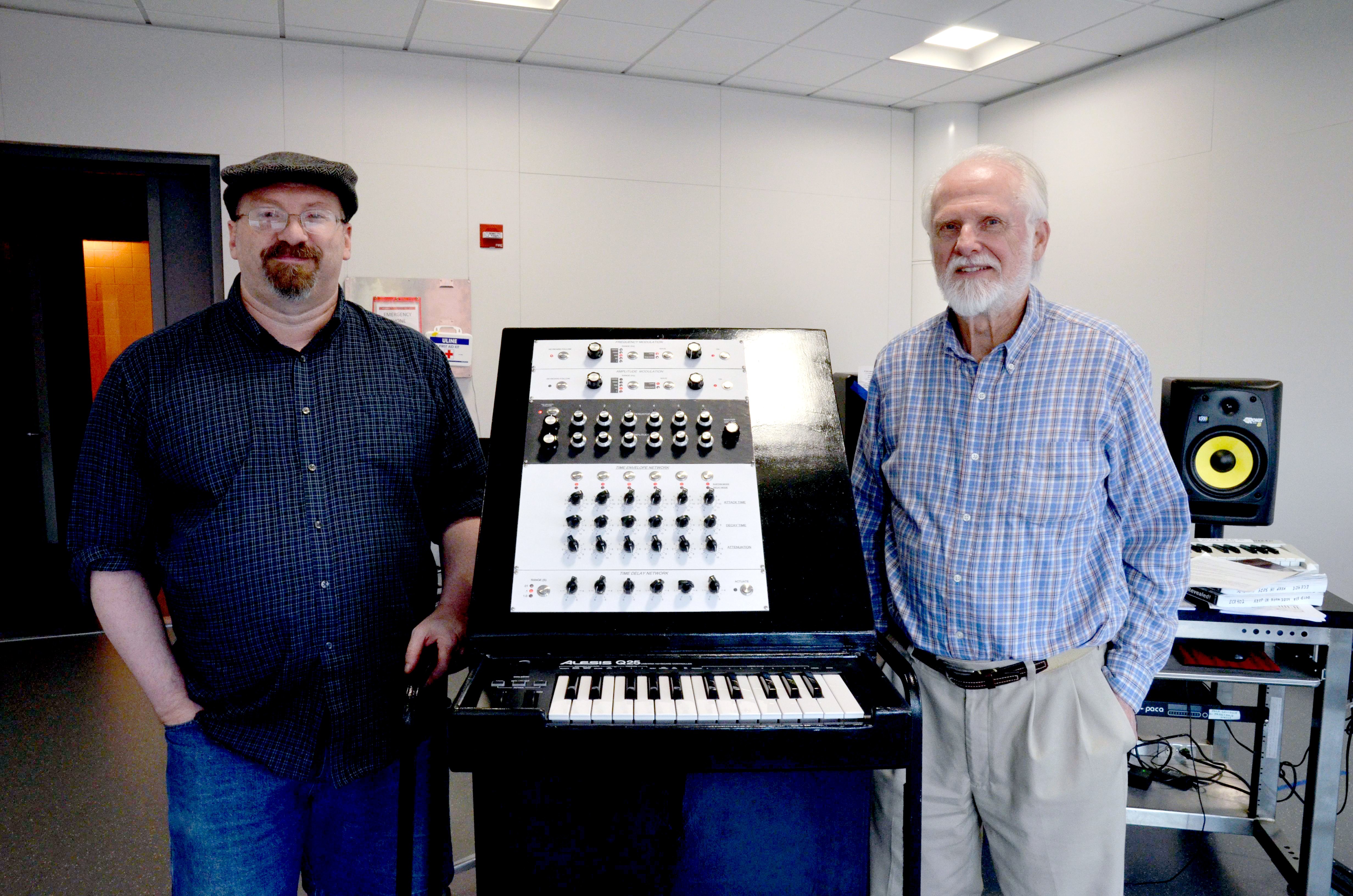 Smart (left) and Beauchamp (right) with the recreated instrument in ECE ILLINOIS' Electronic Music Lab.