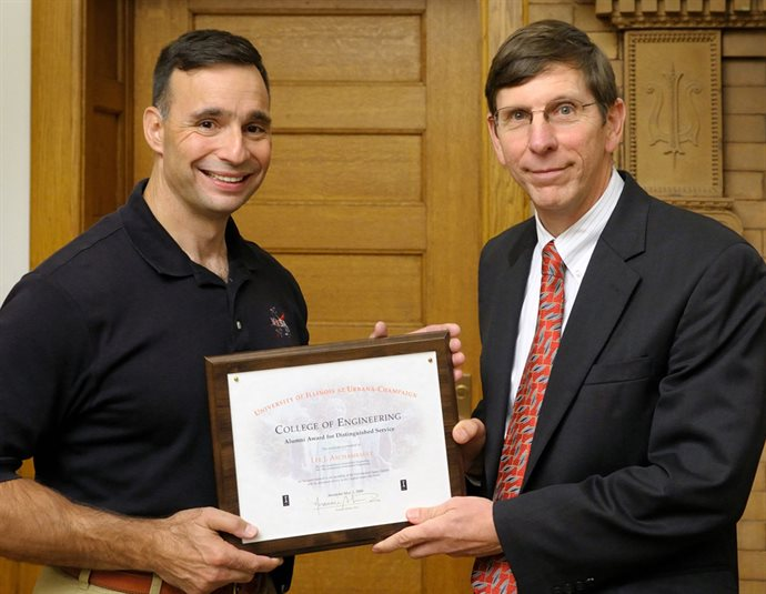 Archambault receiving the Alumni Award for Distinguished Service from former Dean Michael Bragg.