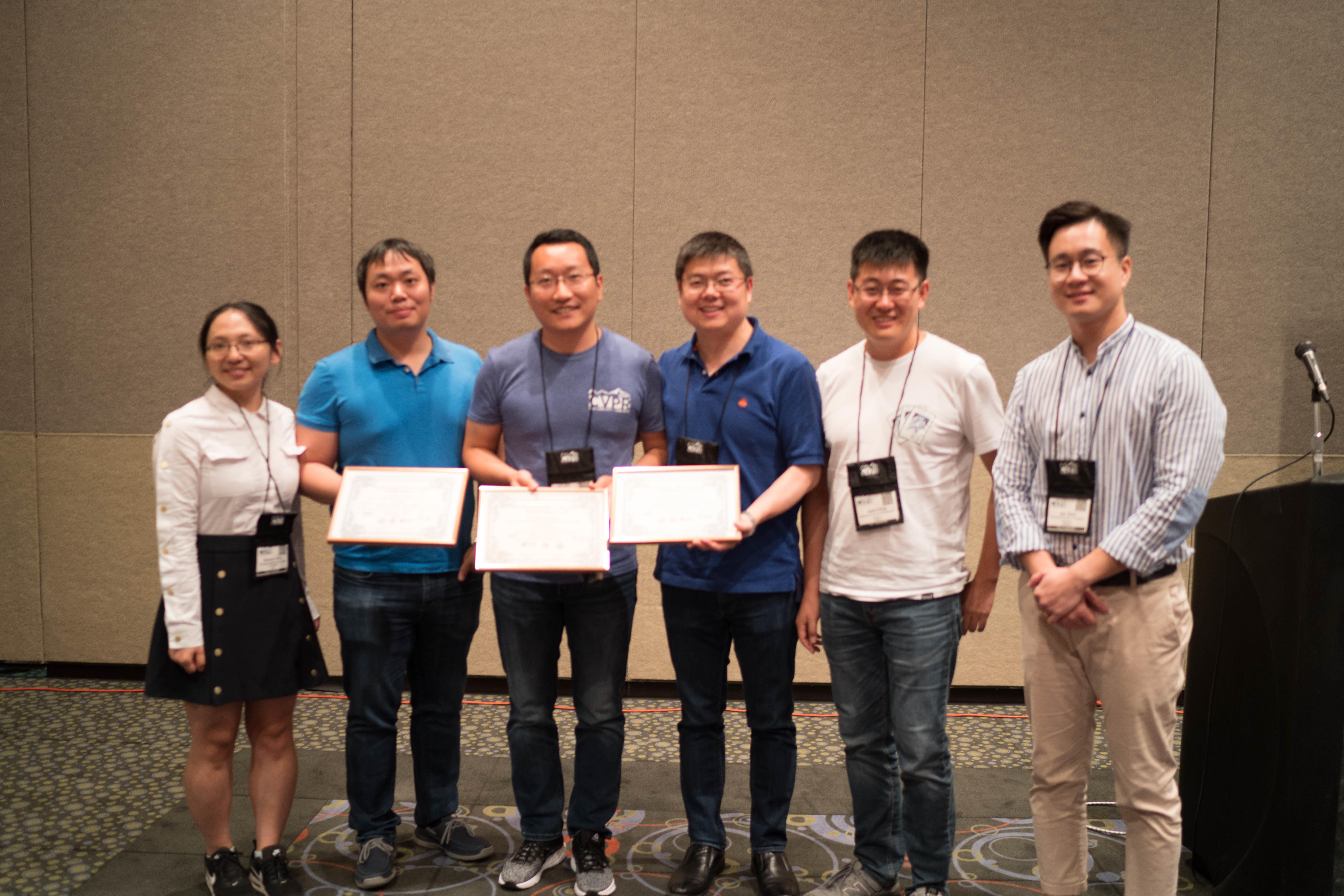 Three members of the team, Honghui Shi (second from left), Yunchao Wei (third from left) and Jinjun Xiong (third from right) accepted their certificates Monday in Salt Lake City.