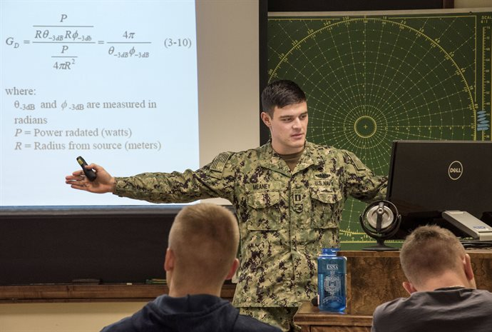 Lt. Daniel Meaney, USN, assistant professor in Naval Science, teaches his Naval Weapon Systems (NS 306) class at the UI Armory during spring semester. The class provides students with the principles of weapons deployment, both offensive and defensive; as well as teaching the theory behind challenges presented to the warfighter, using physics, chemistry, electronics, and cyber. <em>Photo by Heather Coit</em>