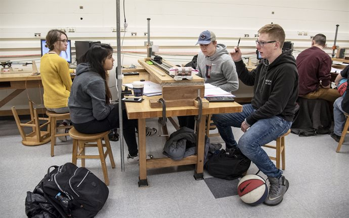 Ryan Nixon&rsquo;s Air Force ROTC lessons in leadership extend to engineering classes, including his leading a small group discussion in Physics 211 lab earlier this spring semester. Nixon isn't the only engineer in his family; his maternal grandfather attended Texas Tech to become a civl engineer. <br /><em>Photo by Heather Coit</em>