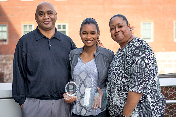 Aja Capel, center, with her father, Parrish Capel, and her mother, Dr. Shawn Love.