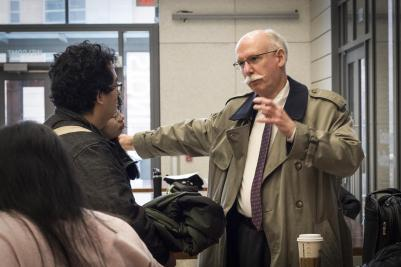 Illinois CS alumnus Scott Fisher talks to students outside a class during a February visit. Fisher has agreed to extend his support of the Scott H. Fisher Computer Science Teaching Award.